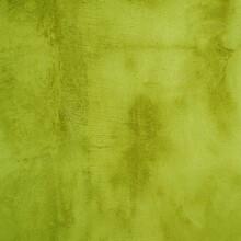 Designer Background From Old Shabby Yellow-green Plaster.