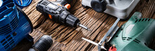 Power Tools On Wooden Desk