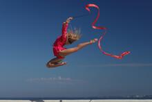 Woman Rhythmic Gymnast With Red Ribbon
