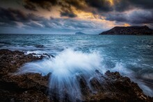 Wave Of The Sea Hitting The Rocks Of A Beach.  Long Exposure Photography.