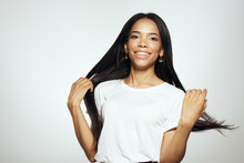 Woman Of African Appearance In White T-shirt Long Hair Studio