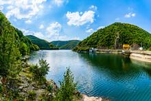 Landscape Of Reservoir Lake Tarnita And The Tarnita Dam On Somesul Cald River Surrounded By Grean Mountains In Cluj County, Transylvania, Romania