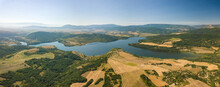 Panoramic View Of A Blue Lake, Agricultural Fields And Mountains Under A Blue Clear Sky