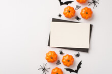 Top View Photo Of Black Envelope White Card Pumpkins Spiders Web And Bats Silhouettes On Isolated White Background With Copyspace