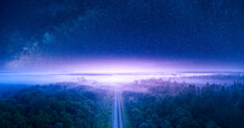 Starry Sky Over Forest And Railway View From Drone