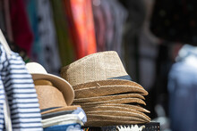 Stack Of Men And Women Summer Hats On The Street Market, Selective Focus, Closeup