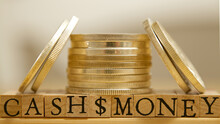 Cash, Money Spelled Out On Wooden Letters With Dollar Sign Between. Silver Coins.
