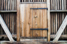 Wooden Barn Door With Iron Awnings