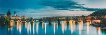 Prague, Czech Republic. Evening Panoramic View Of Evening Cityscape In Night Lighting. Charles Bridge. Famous Landmark, UNESCO World Heritage