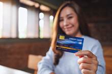 Blurred Image Of A Beautiful Asian Woman Holding Credit Card For Shopping