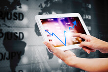 Businesswoman Use Tablet With Growth Finance Chart