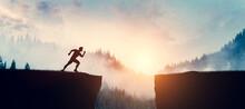 Man Running Up To Jump Between Cliffs At Sunset.