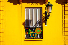 Window With Shutters On The Yellow Wall