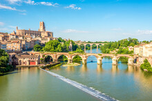 View At The Albi Town With Old Bridge Over Tarn River, France