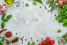 Food Cooking Background. Fresh Saffron, Garlic, Cilantro, Basil, Cherry Tomatoes, Peppers And Olive Oil, Spices Herbs And Vegetables At Light Grey Slate Table. Food Ingredients Top View.