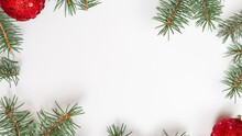 Christmas Frame Composition From Fir Branches. Christmas Gift, Fir Branches On A White Background. Flat Lay, Top View, Copy Space