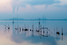 Beautiful Sunset In The Lagoon Of Venice With Calm Water In The Industrial Area Of Porto Marghera