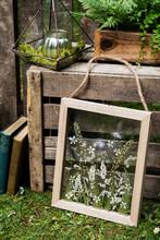 Flower Arrangement In Wooden Frame, Decorations For A Woodland Ceremony