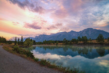 Sunrise Glow Over Canmore Mountains