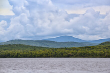 Storm Clouds Brewing Over The Mountains Above Moosehead Lake