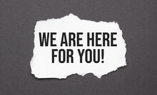 We Are Here For You Sign On The Torn Paper On The Black Background