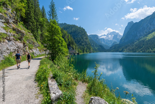 Gosausee, Austria  July 31, 2021 - People hiking at Gosausee, a beautiful lake with moutains in Salzkammergut, Austria.