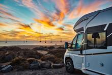 Caravan Parked On Seashore At Sundown