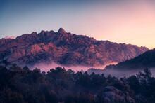 Fog Between Ridges And Boulders At Dawn