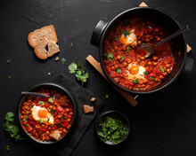 Shakshuka With Vegetables And Egg In Bowl Between Fresh Coriander