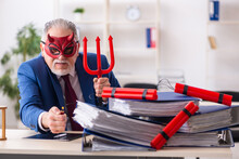 Old Male Devil Employee With Dynamite In The Office