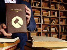 NET NEUTRALITY LAW Inscription On The Book. Net Neutralityis The Concept That All Data Traffic On A Network Should Be Treated Indiscriminately