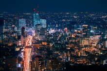 Light Trails In Long Exposure At Night On A Large Artery Of Traffic In Tokyo Metropolis -View From Above At Mori Tower Observation Deck At Roppongi Hills Business Center In Tokyo, Japan.