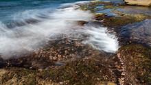 Waves Washing Over Rock Shelf