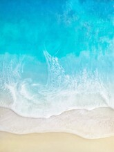 Top View On Sea Waves With White Foam And Light Beige Sand, Resin Art. Close-up Of Deep Rich Blue, Azure, Turquoise Color Of Water, Shore, Ocean. Trendy Painting.