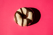 Top View Of A Donut On Pink Background