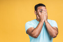 Surprised Amazed African American Indian Man Guy In Casual Isolated Over Yellow Background Studio Portrait. People Lifestyle Concept. Mock Up Copy Space. Keeping Mouth Open.