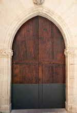 Beautiful Old Wooden Door In The Form Of An Arch In The Old Stone House.