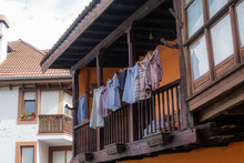 Clothes Hanging On Traditional Balcony Of Northern Spain