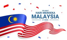 """Vector Illustration Of A Wavy Flag, With The Text """"Selamat Hari Merdeka Malaysia, 31 Ogos"""", Which Means Happy Malaysian Independence Day, 31 August."""