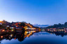 Beautiful Sunsets View Of Ban Rak Thai, Mae Hong Son, Thailand. The Dusk Scene After Sunset With The Reflection Of The Buildings And Night Market