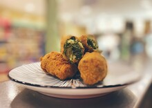 Spinacon Croquettes With Pine Nuts
