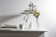 A Vase With Dry Eucalyptus, Pieces Of Paper, A Figurine With A Fox, And A Cup Of Coffee. Scandinavian Style.