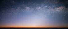 Panorama Beautiful View Universe Space And Milky Way Galaxy With Stars On A Night Sky With Sunlight At Twilight Time Background.