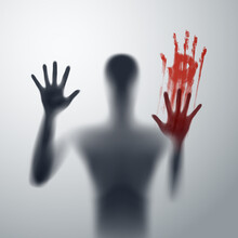Shadow Blur Of Horror Man Behind The Matte Glass. Blurry Hand, Body Figure Abstraction, And Two Palms With Blood. The Reflection Of The Silhouette Through The Light