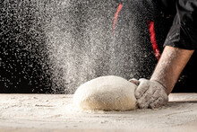 Male Hands Making Dough For Pizza. Beautiful And Strong Men's Hands Knead The Dough Make Bread, Pasta Or Pizza