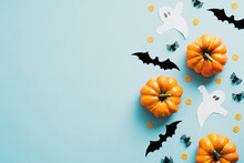 Happy Halloween Party Invitation Card With Decorations, Pumpkins, Ghosts, Bats On Blue Background, Vintage Style. Flat Lay, Top View, Copy Space.