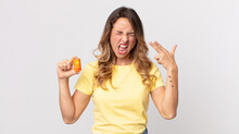 Pretty Thin Woman Looking Unhappy And Stressed, Suicide Gesture Making Gun Sign And Holding Batteries