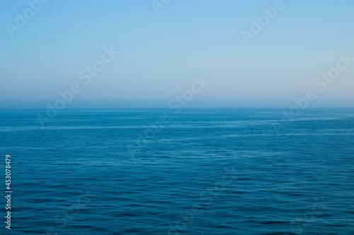 Carta da parati Calm Irish sea in the morning with mist in the background, seascape