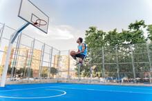 Shirtless Sporty Man Playing Basket