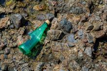 Plastic Bottle Thrown On The Rocks Of Ribeira Beach.